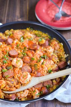 This easy jambalaya recipe is a classic dish of Louisiana. It contains turkey smoked sausage, shrimp, and rice with a ton of flavor all while still being an easy jambalaya recipe to make for your family. Cajun Recipes, Sausage Recipes, Seafood Recipes, Crockpot Recipes, Dinner Recipes, Cooking Recipes, Louisiana Recipes, Haitian Recipes, Donut Recipes