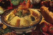 This is my mother-in-law's outstanding recipe for classic Moroccan Couscous with Seven Vegetables. Steamed couscous is piled high with stewed meat and vegetables – very delicious! Omit the meat for a vegetarian couscous. By Christine Benlafquih