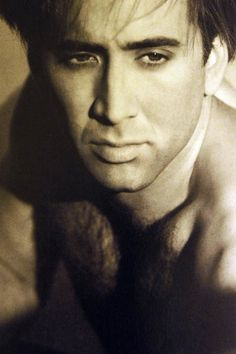 Nicolas Cage. Again, i still don't know why I find him attractive, by boy do i?!