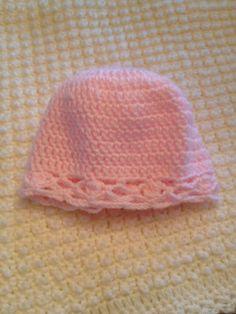 Pink crocheted baby cap.  I've made dozens of these for our church's crochet club who disperses these to the hospitals.