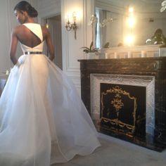 Asymmetrical back of this Romona Keveza gown! | #bridalmarket #bridalfashionweek | www.instagram.com/theknot