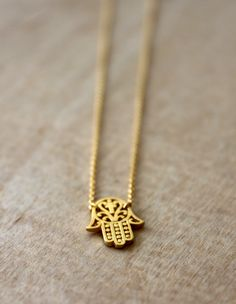"""The symbolism of the hamsa is deeply rooted in the middle eastern lore. For centuries, people have considered it to be an amulet that wards off evil and attracts prosperity. Wear your necklace as a daily reminder of the goodness, endurance, fertility, luck and good health your necklace brings.  Hamsa charm measures w=0.50"""" x h=0.60"""" and chain is adjustable from 16"""