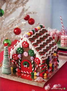 crochet gingerbread house @S R. Cecilia Ross made me think of you:) cute isn't it?