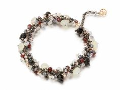 Around 200 semi-precious stones individually attached on this bracelet, include: moonstone, onyx, rose quartz, iolite, garnet, grey and white...
