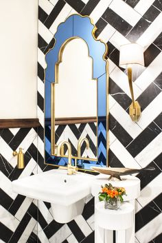 Stunning powder room features walls clad in black and white chevron tiles lined with a Bunny Williams Sapphire Mirror illuminated by a Ruhlmann Single Sconce in Hand Rubbed Antique Brass over a wall-mounted sink and gold gooseneck faucet. Luxury Decor, Luxury Interior, Interior Styling, Interior Decorating, Interior Design, Chevron Tile, Herringbone Tile, Bunny Williams Home, Decor Pad