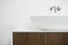 Ellipse; Adding lightness and elegance. Meet our Ellipse countertop basin. Similar in shape to our Ellipse bathtub it is defined by its thin border and absent base. A smooth oval design adding lightness and elegance to both modern and classic bathrooms. The Ellipse basin looks great on any surface. Made from durable solid surface and equipped with a matching waste cover for a clean look. #bathsbyclay #Ellipse #madetomeasure #solidsurface #bathroomdesign #designwithoutcompromise