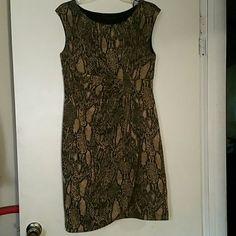 Snake skin pattern dress Easy to take care of. No iron dress :) Crosses on the side Size 12 tiana b. Dresses Midi