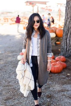 white tee, plaid shirt, gray duster cardigan, black flats, black jeans, check scarf