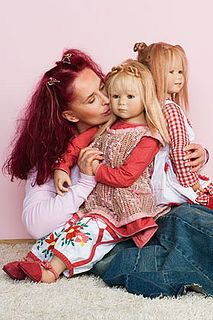Doll artist Annette Himstedt  with two of her dolls