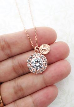 A simple and elegant a luxe halo style Clear Round Cubic Zirconia drop necklace with a personalised initial.  This listing represents (1) necklace only.  ✦ Necklace: 16.5 inch  2 inch extender, rose gold plated ✦ Cubic zirconia drop: 13 mm   ✦ Please let me know your EVENT date when you check