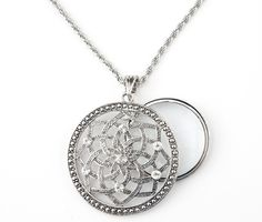 Fashion and function collide with our Lotus Charmed Life Magnifier Necklace! You'll be living a charmed life in this beautiful necklace with magnifier that provides 5x magnification