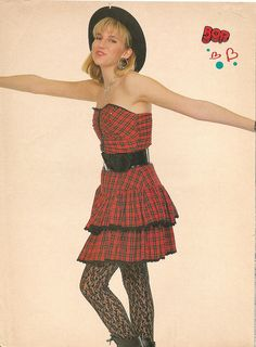 Debbie Gibson 80'S BOP Magazine pin up with strapless red plaid dress , black belt , lace black stockings and black fedora hat