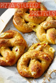 Pizza stuffed pretzels: gigantic, soft pretzels stuffed with your favorite pizza toppings and dunked in spicy tomato sauce.