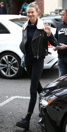 Her own style: Behati Prinsloo bundled up in a leather jacket and platform shoes for a fri...