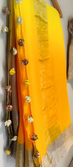 Floral tassles on a pleasant mango saree
