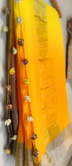 Floral tassles on a pleasant mango saree