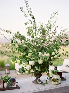 lush floral arrangement at this romantic White Wedding in Napa