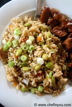 Edamame Egg Fried Rice:     3 cups cooked Brown Rice     1 Whole Egg      2 Egg Whites      1 tbsp Sesame Oil     1 small Onion, finely chopped     2-3 cloves Garlic, finely chopped     3-4 Scallions thinly sliced     1/2 cup Bell Peppers, chopped     1 cup boiled Edamame     2 tbsp Soy Sauce     Salt, Pepper to taste