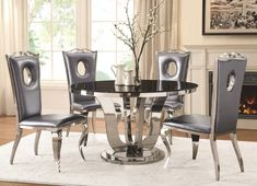 5 pc Blasio collection chrome metal base round dining table set with black glass top. This set includes the table with 4 - side chairs. Metallic grey leatherette side chairs measure x H x Addit Round Dining Table Sets, Glass Top Dining Table, Counter Height Dining Sets, Pub Table Sets, 5 Piece Dining Set, Dining Tables, Dining Rooms, Dining Area, Kitchen Tables