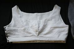The making of a medieval bra-shirt, including hand-done eyelets for the drawstring. - Deventer Burgerscap: Making my bra-shirt part I