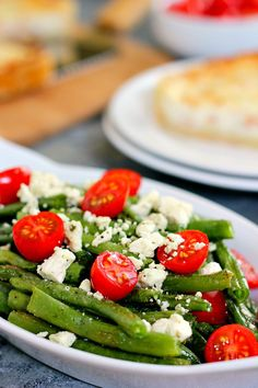 This Roasted Garlic Green Bean Salad is filled with fresh beans, ripe tomatoes and feta cheese, combined with a light garlic and lemon dressing!: