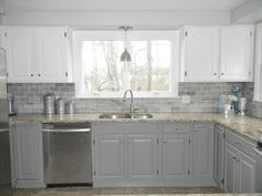 Kirk hired painters to spray the cabinets different colors for a two-toned kitchen. The top cabinets are painted with Benjamin Moore's Dove White and the bottom cabinets are painted with Benjamin Moore's Chelsea Gray.