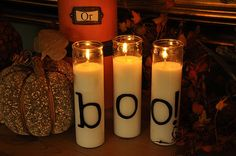These tall candles are from the dollar store – cheap!  I didn't want to spend money on vinyl so I just used black contact paper and cut it using my Cricut machine.  If you don't have a Cricut machine (not cheap) you can just print the letters on paper and then wrap the paper around the candle.