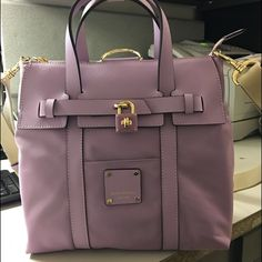 Henri Bendel small lavender color back pack Brand new! And I have everything that comes with it. It's a beautiful color! henri bendel Bags Backpacks