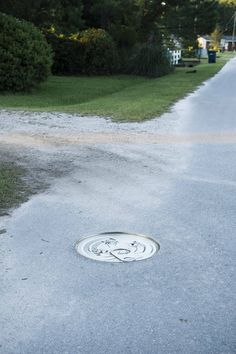 Surreal Photography by Paige Marie Bennett, Traffic Jam.  Paige Bennett, Bennett, Paige, Paige Marie Bennett, Surreal, Surrealism, Surrealist, Fantasy, Fantastic, Awesome, Art, Photography, Photographer, SCAD, Savannah College of Art and Design, Artist, Manhole Cover, Manhole, Can, Canned Good, Canned Goods