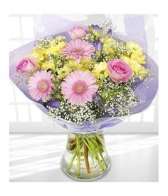 Buy this pretty and sweet flower bouquet, with gorgeous pastel flowers and colours from overseasflowerdelivery.com . Our Stunning mix of pink, yellow and purple flowers always for your loved ones.
