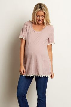 Add a feminine piece to your basics this season with this pretty maternity top. You can be sure to keep cool in this short sleeve and feel beautiful with a crochet trim detail. Style this top with maternity jeans and flats for stunning everyday casual wear.