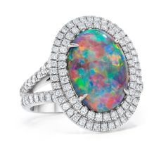 This Beautiful Opal with Double Diamond Halo would look perfect with any summer outfit! By @Jeffrey Kalmikoff Daniels Unique Designs