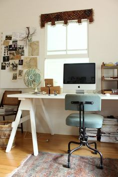 DIY desk, two saw horses and a pine plank, painted, poly'ed.  easy. cheap.