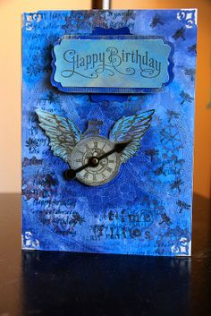 Time Flies - Hero Arts Time Fly stamp, SU Happy Birthday from Perfectly Penned collection, and gears from Inkadinkadoo.  Items stamped and embossed with clear or gold, then colored with layers of Tim Holtz distress paints and buffed with Inka Gold Metallic Rub.