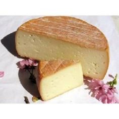 Tomme des Pyrénées. French cheese from the Pyrénées made of milk from cows, sheeps and goats.