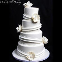 Oak Mill Bakery is a Chicago, IL based wedding cakes and desserts shop. We have specially designed cakes for wedding reception and parties.