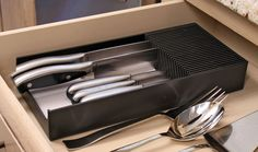 Amazon.com: Plastic KNIFEdock - In-Drawer Knife Storage Rack. Replace your old knife block with a revolutionary new product. Clear your counter top clutter, and easily identify the desired knife every time. KNIFEdock makes all other knife blocks obsolete.: Kitchen & Dining