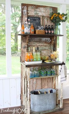 DIY outdoor, backyard, garden party Beverage Bar Station using a recycled door with added shelves. Notice the bottle opener near the top left of the door.