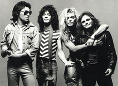 Van Halen = 2 Xs Eddie Van Halen & David Lee Roth in leather pants