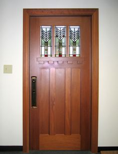 """Craftsman Door Collection  DbyD-4167. This Craftsman Door is located in our showroom here in Montgomery, Alabama. It is a 36"""" x 80"""" Honduran Mahogany door displaying leaded stained glass based on a popular Frank Lloyd Wright design. The customledge and dentil molding added detailcompletes the look. Doors by Decora."""