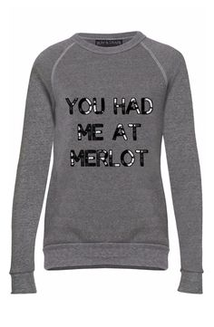 "Cozying up in this soft raglan-sleeve sweatshirt with an amusing message spelled out in hand-sewn sequins front and center. This sweatshirt that says ""You had me  at merlot"" is perfect for the wine lover."