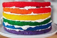 """How To Make the Ultimate Rainbow Surprise Cake. Maybe you've seen cakes like this on Pinterest, your favorite baker's Instagram feed, or even IRL at your best friend's house and thought to yourself, """"That cake looks so fun and complicated; I could never make that."""" I'm here to encourage you otherwise! You can totally make this knock-out, show-stopping surprise-inside rainbow layer cake from scratch."""