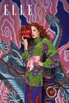 Actress Jessica Chastain wears Gucci blouse, belt and pants
