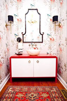 Statement Rug: A stunning Asian-inspired powder room caught my eye as it features girly chinoiserie-esque wallpaper, a red lacquer vanity, and a luxurious oriental rug that more timid homeowners might be afraid to put down in a wet room.