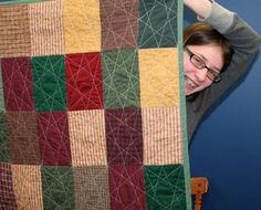 Calley Knapp and the quilt she made that will be displayed in the Great Lakes Seaway Trail War of 1812 Bicentennial Quilt Show.