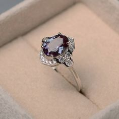 This ring features a 7*9 mm oval cut lab alexandrite and sterling silver finished with rhodium. Customization is available. It is made by hand, and it will take about 7 days to finish the ring after your payment is completed. Main stone: lab alexandrite weight: Approx 2.27 ct Metal type: