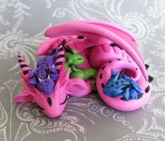 Mama Dragon with Three Babies by DragonsAndBeasties