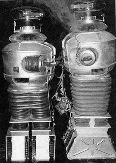 Did you know that Robot (B9) in the television show Lost in Space had a stunt double to handle situations that required rough treatment? Here are the two robots, side-by-side. Bob May played Robot.