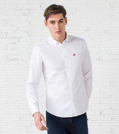 Camisa de manga larga en tejido de pinpoint con coderas de vichy. Cuello abotonado.
