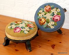 A pair of late 19th century ebonised stools with needlepoint covers